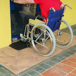 Wheelchair going up access ramp